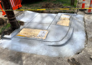 A newly formed and placed concrete curb sets up in Raleigh, NC.