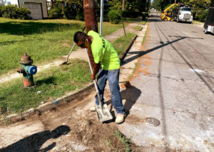 A Fulford & Jones Asphalt, Inc. employee tamps down exposed dirt to prepare a curb for new concrete in North Carolina.