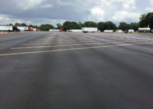 Newly paved asphalt with lined parking spaces at Kenly 95 Truckstop in Kenly, NC.