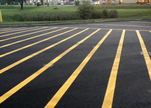 Yellow lines denote a no parking area in a truckstop parking lot in Kenly, NC.