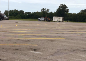 A worn and dirty truckstop parking lot.