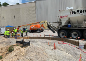 A volumetric concrete mixer backs up to place concrete at Merck in Wilson, NC.
