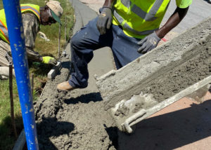 Workers place concrete for a new curb in Morrisville, NC.