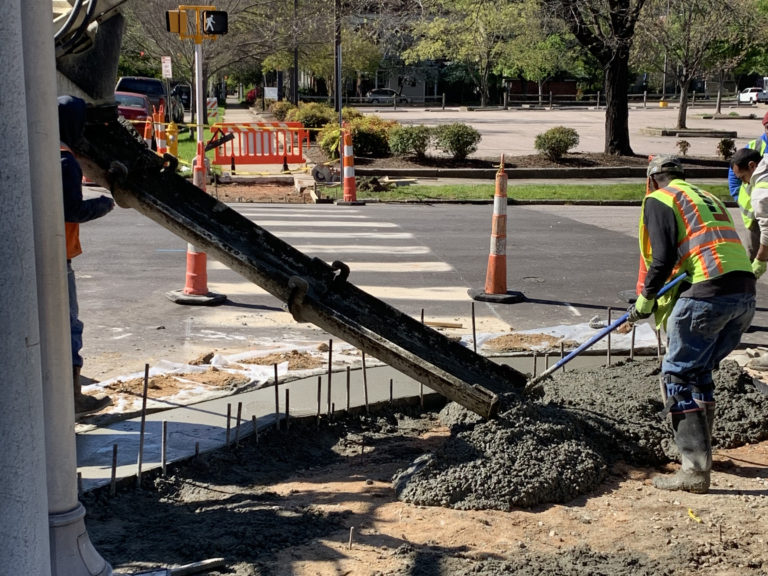 A volumetric concrete mixer pours concrete into wooden forms for a new sidewalk in North Carolina.